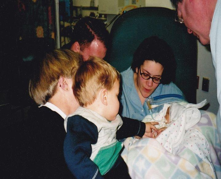 <p><em>Luke meeting his baby sister, Emma on March 9, 2001.</em></p>