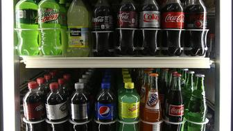 SAN FRANCISCO, CA - JUNE 10:  Bottles of soda are displayed in a cooler at a convenience store on June 10, 2015 in San Francisco, California. The San Francisco board of supervisors has approved an ordinance that would require warning labels to be placed on advertisements for soda and sugary drinks to alert consumers of the risk of obesity, diabetes and tooth decay. The ordinance would also ban advertising of sugary drinks on city-owned property. If San Francisco mayor Ed Lee approves the  measure, the law would be the first of its kind in the nation.  (Photo by Justin Sullivan/Getty Images)