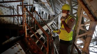 Aaron LaRocca, Chief of Staff of the George Washington Memorial Parkway, looks at a trunnion post that needs replacement under the draw span on the Arlington Memorial Bridge in Washington, U.S., June 20, 2016.      REUTERS/Joshua Roberts