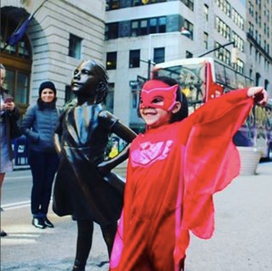 """People checking out """"The Fearless Girl"""" statue couldn't get enough of Abrianna and took photos of her."""