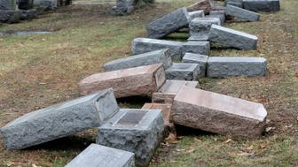 A row of more than 170 toppled Jewish headstones is seen after a weekend vandalism attack on Chesed Shel Emeth Cemetery in University City, a suburb of St Louis, Missouri, U.S. February 21, 2017.  REUTERS/Tom Gannam
