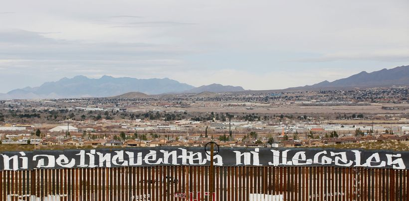 'Neither criminals nor illegals': activists painted the U.S.-Mexico border in protest against US President Donald Trump's new