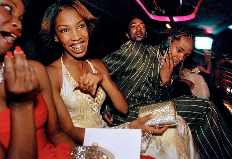 """Crenshaw High School girls selected by a magazine to receive """"Oscar treatment"""" for a prom photo shoot take a limo to the event with their dates, Culver City, California, 2001."""