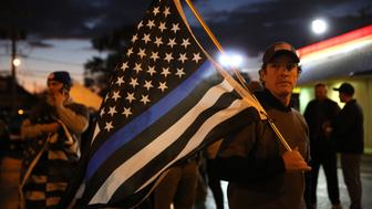A group supporting Blue Lives Matter gathers in the Mount Greenwood neighborhood, Tuesday, Nov. 8, 2016 where Joshua Beal was shot to death by an off duty Chicago police officer on Saturday in Chicago. (E. Jason Wambsgans/Chicago Tribune/TNS via Getty Images)