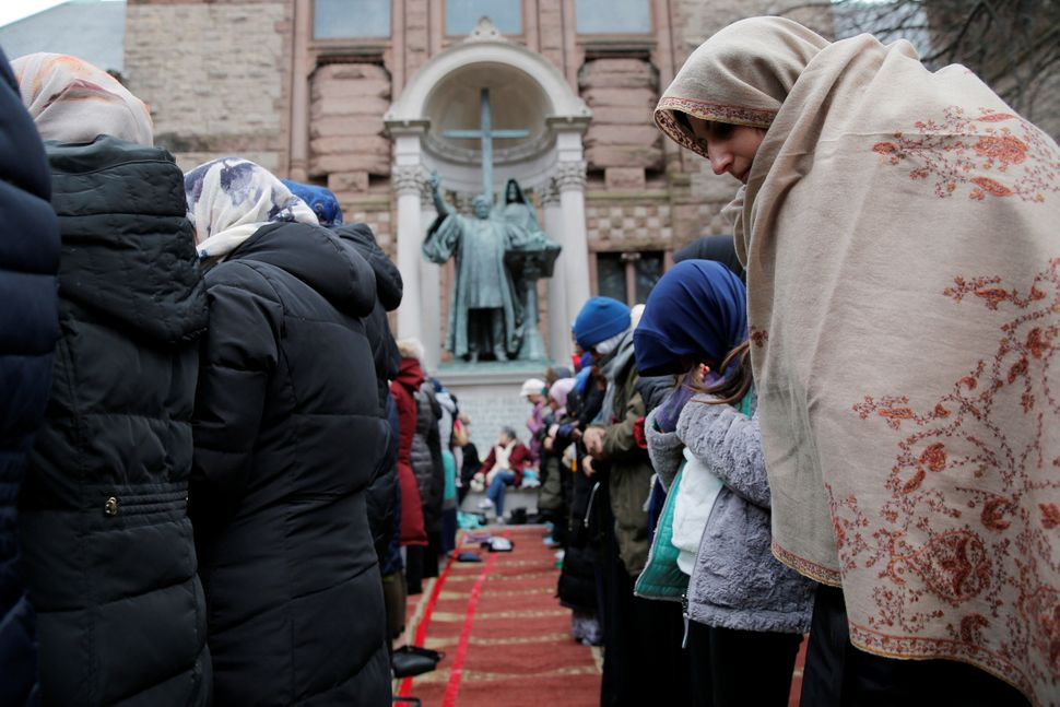 Muslim women pray during a protest against President Donald Trump's travel ban on Jan. 29, 2017.