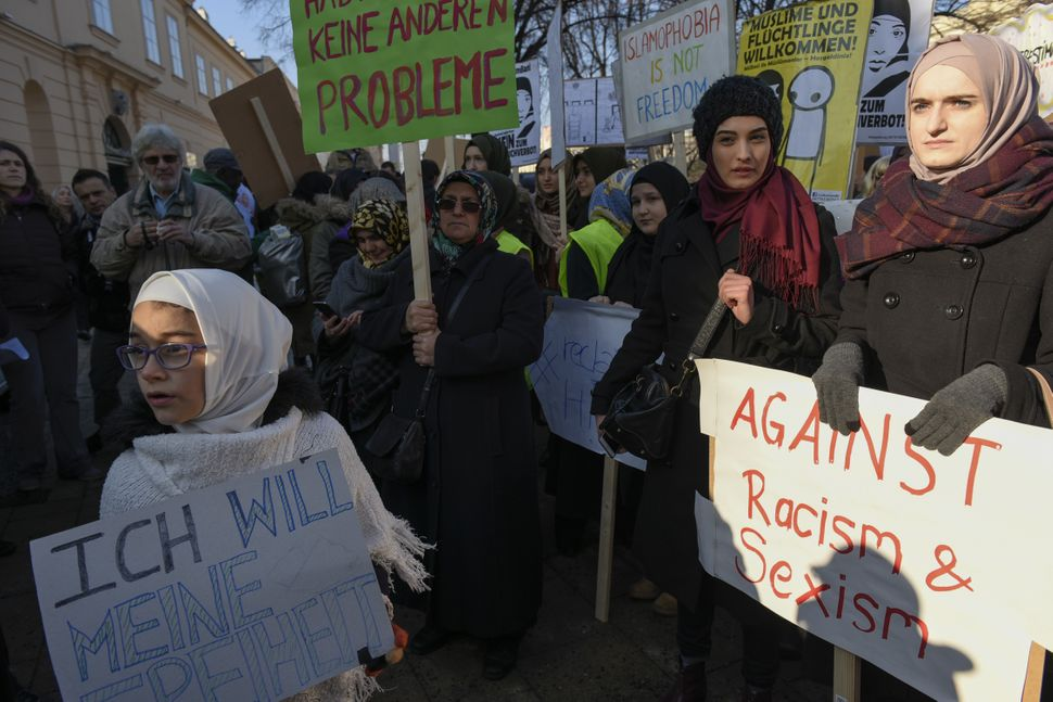 Muslims and Austrian citizens attend a protest against a headscarves ban proposed by the government's ruling coalition in Vie