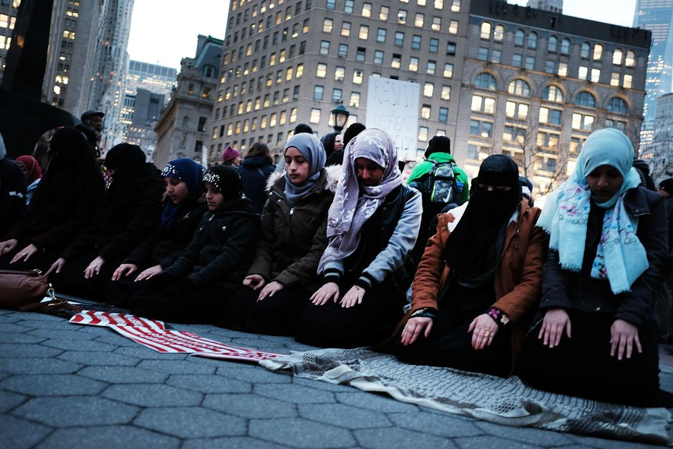 Muslim women pray before a protest in lower Manhattan against the polices of President Donald Trump on Feb. 1, 2017, in New Y