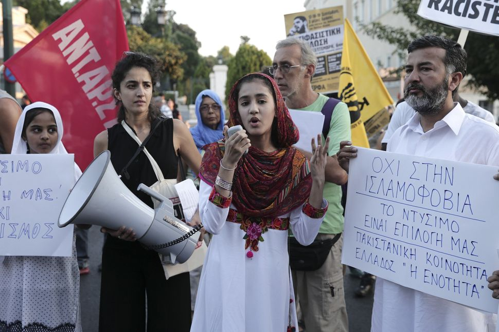 Protesters demonstrate against discrimination of Muslim women in Athens, Greece on Aug. 30, 2016 after 15 French towns i