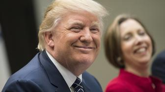 U.S. President Donald Trump smiles during a National Economic Council listening session with small and community bank executives in the Roosevelt Room of the White House in Washington, D.C., U.S., on Thursday, March 9, 2017. Trump assured a group of U.S. community bank executives he will deliver regulatory changes that will make it easier for them to lend money. Photographer: Kevin Dietsch/Pool via Bloomberg
