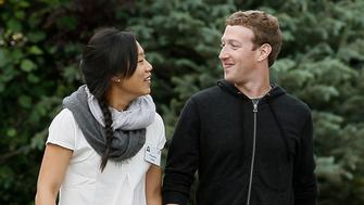Facebook CEO Mark Zuckerberg walks with his wife Priscilla Chan at the annual Allen and Co. conference at the Sun Valley, Idaho Resort July 11, 2013.  REUTERS/Rick Wilking (UNITED STATES - Tags: BUSINESS)