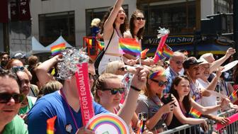 spectators at the gay pride parade in NYC