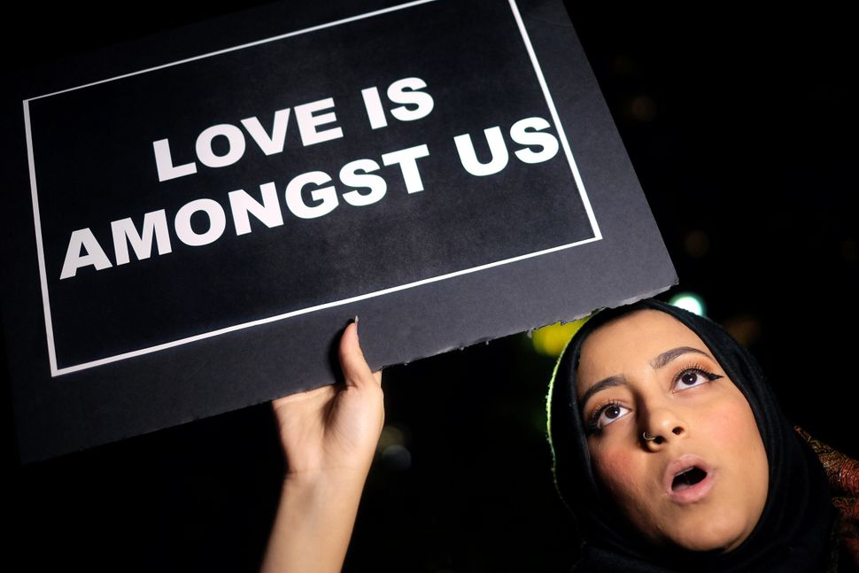 A Muslim woman displays a sign as she joins other human rights activists during a demonstration in New York on Dec. 10,