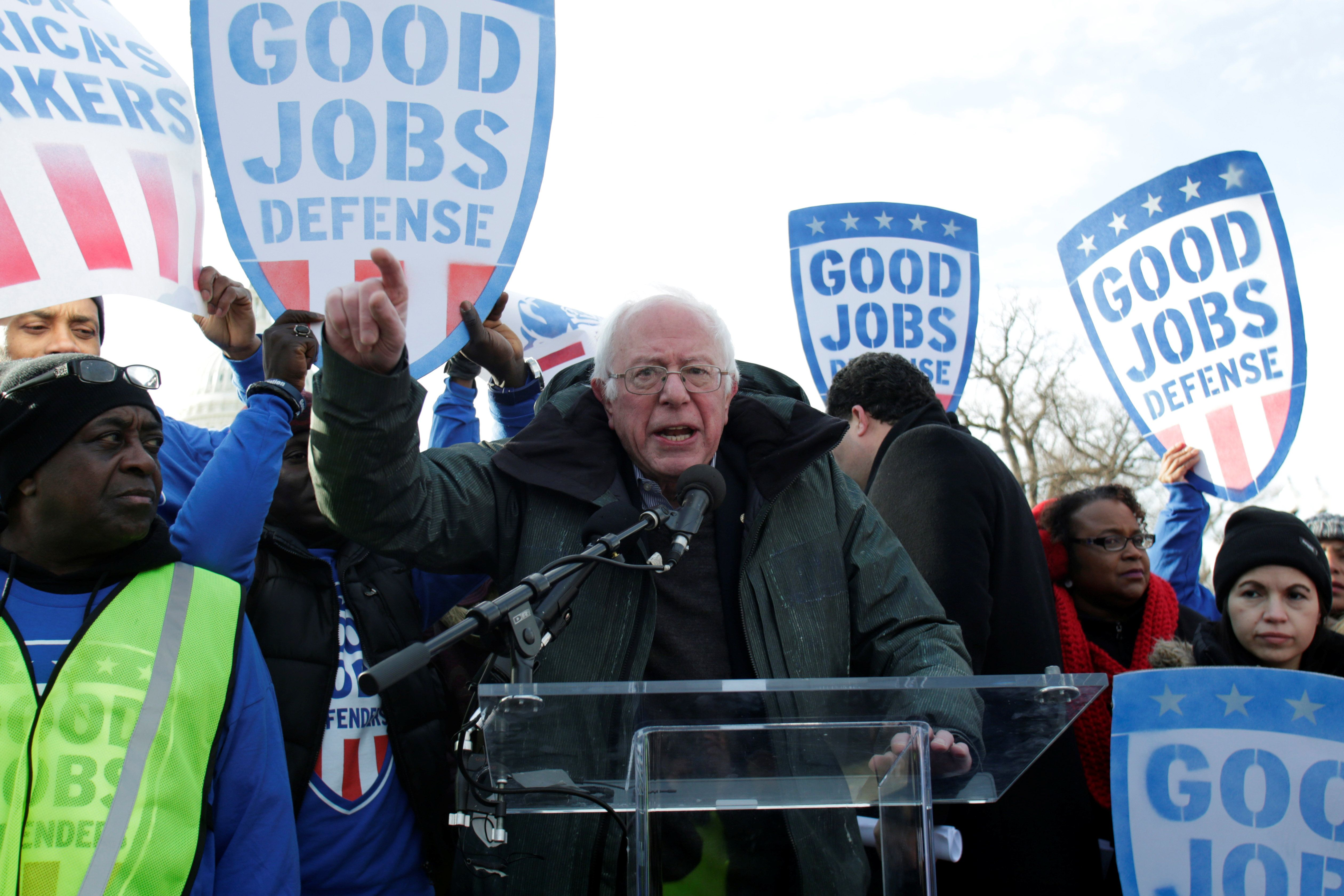 Sen. Bernie Sanders speaks at a federal contract workers rally on Feb. 16 to celebrate Andrew Puzder's decision to withd