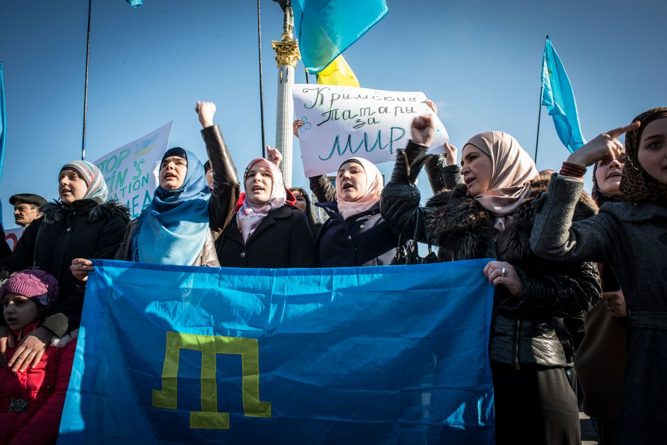 Tatar women visit Kiev's Maidan Square during International Women's Day in 2014 to protest for Ukraine Unity. The Tatar