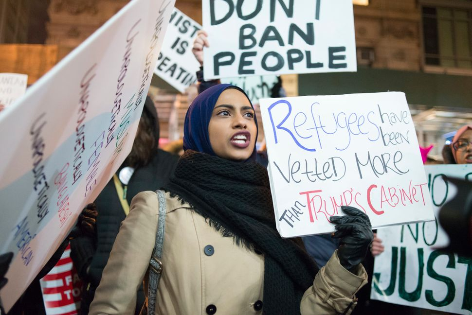 A woman in the crowd chants in opposition to the Muslim Ban in New York City on Feb. 11, 2017.