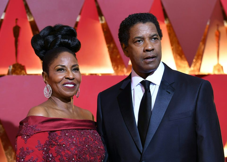 Nominee for Best Actor 'Fences' Denzel Washington arrives on the red carpet with his wife Pauletta for the 89th Oscars on Feb
