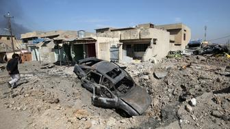 A picture taken on March 9, 2017 shows the rubble of destroyed homes and vehicles in the Shuhada neighbourhood of west Mosul, as Iraqi forces advance against Islamic State (IS) group fighters inside the city / AFP PHOTO / AHMAD AL-RUBAYE        (Photo credit should read AHMAD AL-RUBAYE/AFP/Getty Images)