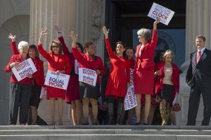Democratic women House members appear outside the Capitol to support A Day Without A Woman rallies.