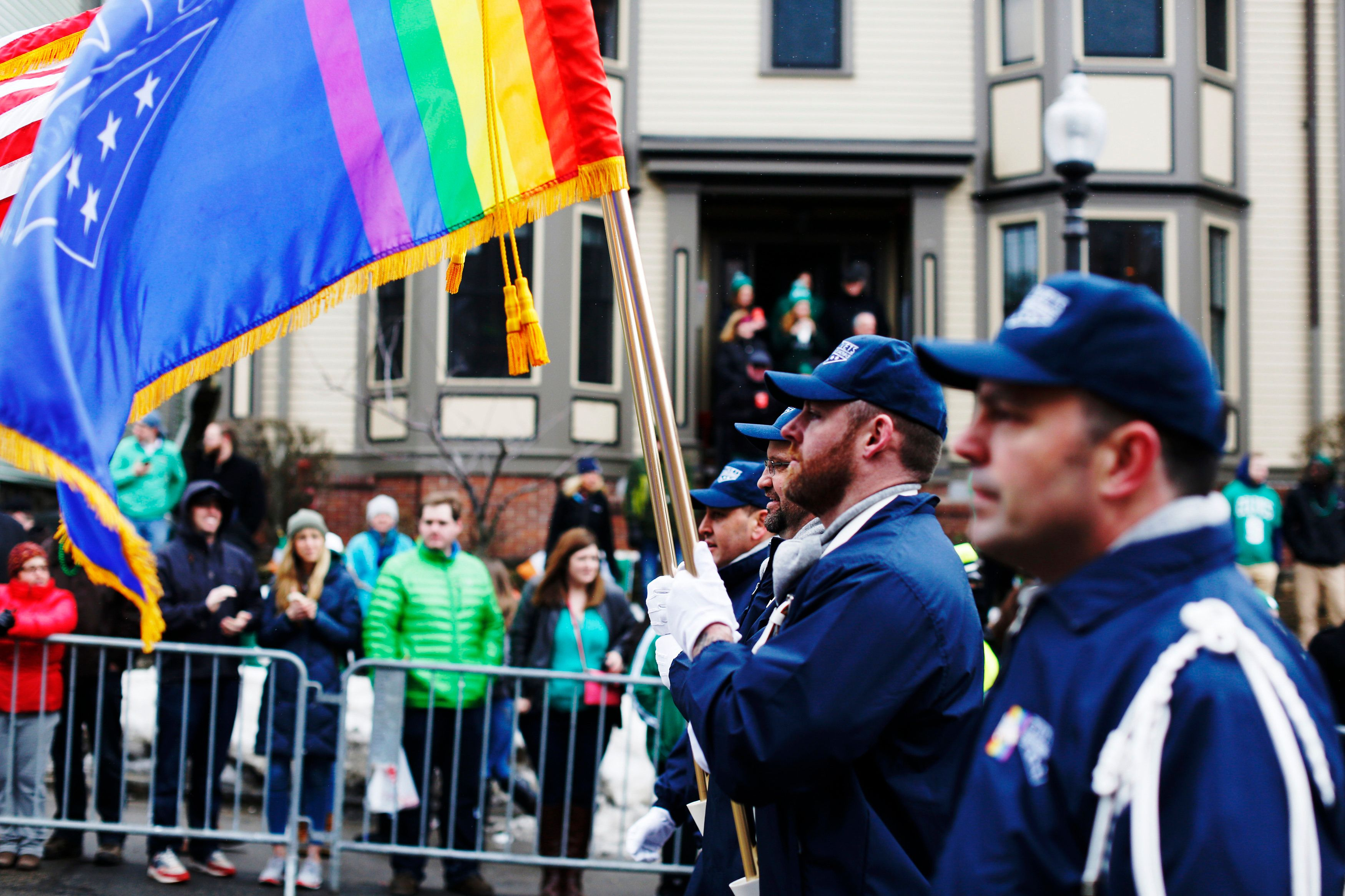 The color guard for LGBT veterans group OutVets marches down Broadway during the St. Patrick's Day Parade in South Boston, Massachusetts  March 15, 2015. For the first time in the 114-year history of Boston's St. Patrick's Day parade, gay rights activists marched openly on Sunday under rainbow banners in the city's annual celebration of its Irish heritage, after organizers lifted a longtime ban. Two groups, Boston Pride and OutVets, were among dozens of contingents taking part in the parade through the center of South Boston, once an insular Irish-American neighborhood near downtown that has undergone gentrification in recent years. REUTERS/Dominick Reuter (UNITED STATES - Tags: SOCIETY ANNIVERSARY)