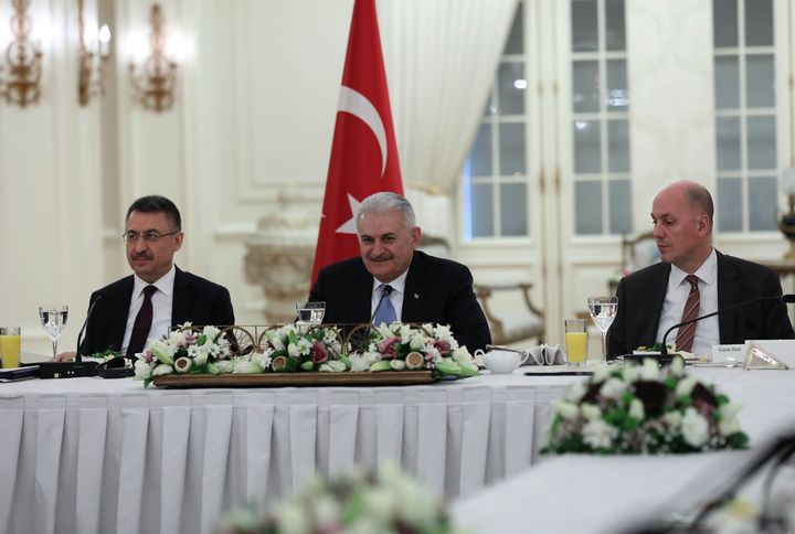 Prime Minister Binali Yildirim (center) told a group of foreign reporters on Thursday that he is optimistic about improved U.