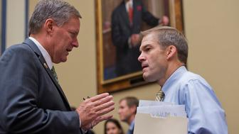 UNITED STATES - SEPTEMBER 19: Reps. Mark Meadows, R-N.C., left, and Jim Jordan, R-Ohio, talk before a House Oversight and Government Reform Committee hearing in Rayburn titled 'Reviews of the Benghazi Attacks and Unanswered Questions.' (Photo By Tom Williams/CQ Roll Call)