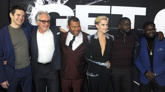 LOS ANGELES, CA - FEBRUARY 10:  Producer Jason Blum, actor Bradley Whitford, writer/director Jordan Peele, actress Allison Williams, actor Daniel Kaluuya and actor Milton ÒLil RelÓ Howery arrive for the Screening Of Universal Pictures' 'Get Out' held at Regal LA Live Stadium 14 on February 10, 2017 in Los Angeles, California.  (Photo by Albert L. Ortega/Getty Images)