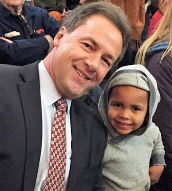 Menny with Montana's Governor Steve Bullock at a Chanukah Celebration