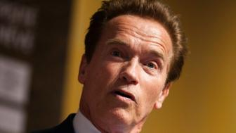 Former California Governor Arnold Schwarzenegger attends the Road to Rio meeting ahead of the UN Conference on Sustainable Development at the CICG in Geneva March 7, 2012. The Rio+20 UN Conference on Sustainable Development taking place in Rio from June 20 to 22 2012 will address topics related to the Green Economy and Climate Change. REUTERS/Valentin Flauraud (SWITZERLAND - Tags: POLITICS)