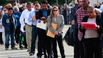 People wait in line to enter the Nassau County Mega Job Fair at Nassau Veterans Memorial Coliseum in Uniondale, New York October 7, 2014.   REUTERS/Shannon Stapleton/File Photo