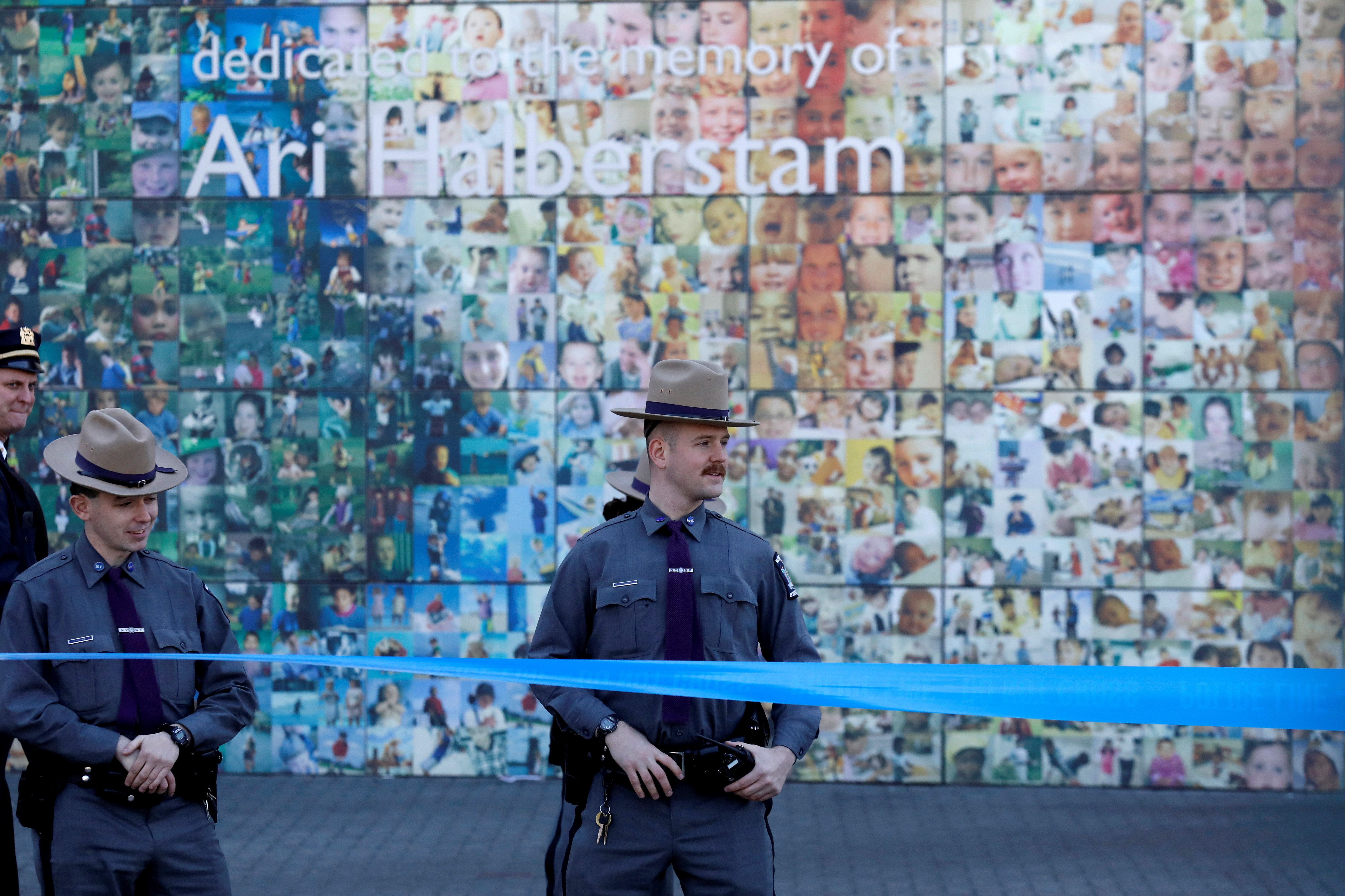 New York State Police officers stand outside The Jewish Children's Museum following a bomb threat in the Brooklyn borough of New York City, U.S. March 9, 2017. REUTERS/Brendan McDermid