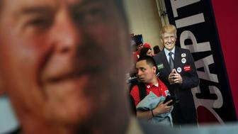 A cutout of Republican US presidential hopeful Donald Trump (R) and former US President Ronald Reagan (L) are seen during the American Conservative Union Conservative Political Action Conference 2016 at the Gaylord National Resort and Convention Center March 4, 2016, in Oxon Hill, Maryland. / AFP / Brendan Smialowski        (Photo credit should read BRENDAN SMIALOWSKI/AFP/Getty Images)