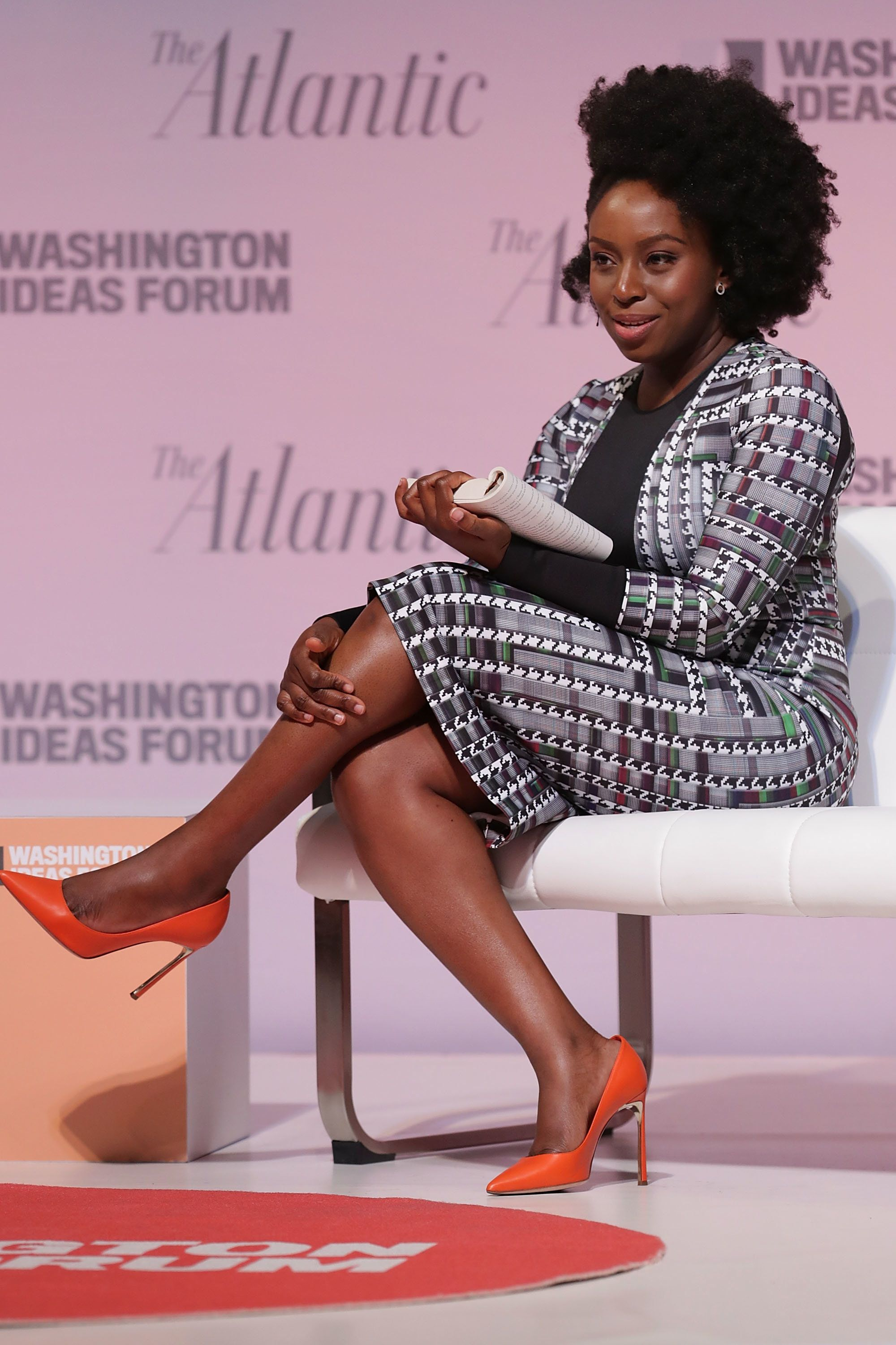 WASHINGTON, DC - SEPTEMBER 28:  Author Chimamanda Ngozi Adichie reads from one of her novels during the Washington Ideas Forum at the Harman Center for the Arts September 28, 2016 in Washington, DC. Adichie said she would have a very difficult time writing about racism and the recent shootings of unarmed black men in America, saying, 'I almost feel that language has failed me.'  (Photo by Chip Somodevilla/Getty Images)