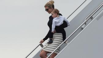Ivanka Trump steps off Air Force One with her son Theodore upon arrival in West Palm Beach, Florida, on March 3, 2017. / AFP PHOTO / NICHOLAS KAMM        (Photo credit should read NICHOLAS KAMM/AFP/Getty Images)