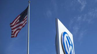 An American flag is pictured at a Volkswagen dealership in Carlsbad, California, September 21, 2015. Volkswagen shares plunged more than 20 percent on Monday, their biggest ever one-day fall, after news that the German carmaker had rigged U.S. emissions tests, and Germany said it would investigate whether data had been falsified in Europe too. REUTERS/Mike Blake