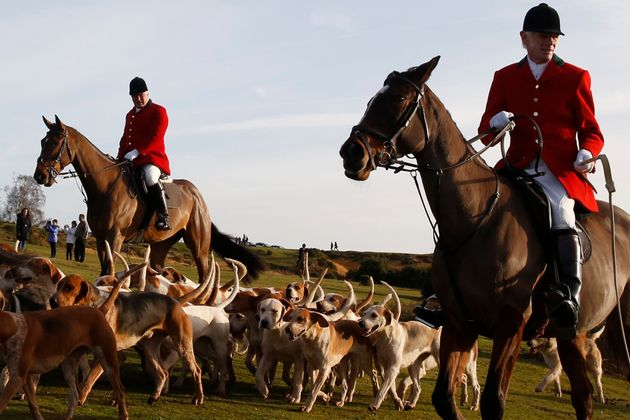 Members of the New Forest Hunt arrive at Boltons Bench for the annual Boxing Day hunt in Lyndhurst, Hampshire...