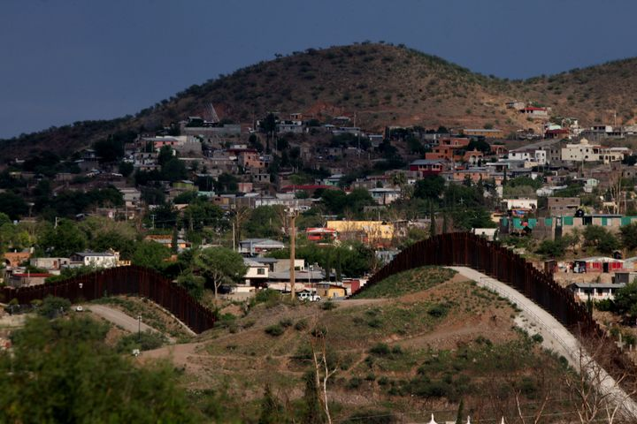 The U.S.-Mexico border wall is shown on July 8, 2012, in Nogales, Arizona. Several hundred miles' worth of barriers already s