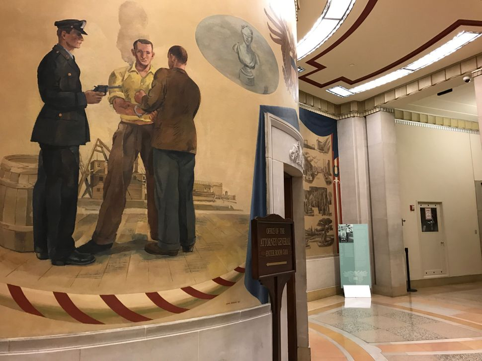 A mural outside Attorney General Jeff Sessions' office in the Robert F. Kennedy Department of Justice Building.
