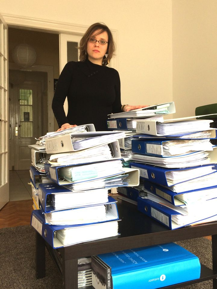 Stacks of trouble: Dóra Papp, Managing Director of Hungarian NGO Krétakör, with the files demanded by the tax authorities.