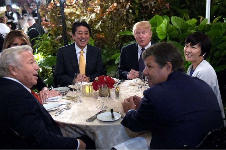 President Donald Trump and Japanese Prime Minister Shinzo Abe, seated next to him, at dinner at Mar-a-Lago on Feb. 10, shortl