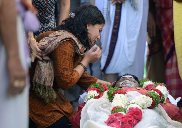 Sunayana Dumala says goodbye to her husband,Srinivas Kuchibhotla, during a funeral ceremony in...