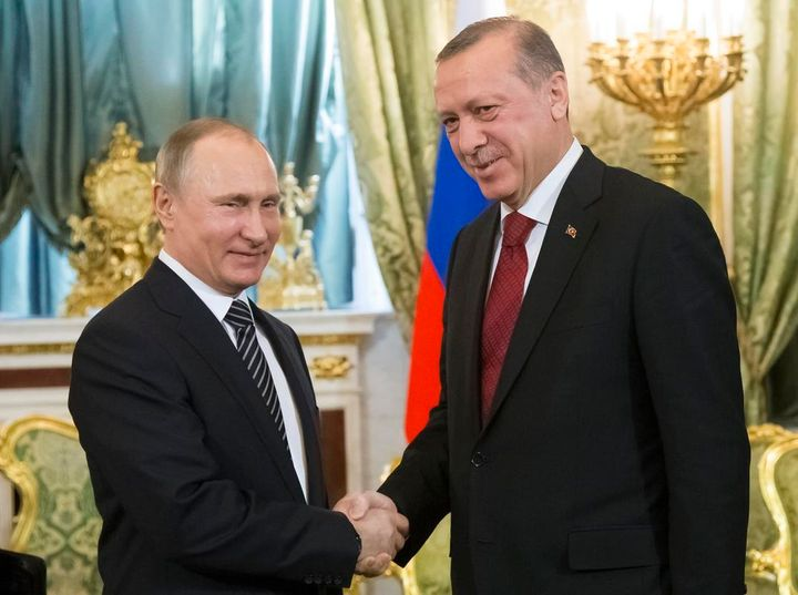 <em>Russian President Vladimir Putin (L) and Turkish President Recep Tayyip Erdogan shake hands in Moscow on Friday. Photo Cr
