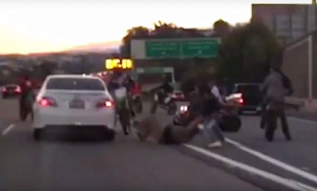 Bikes surround motorist in brutal beating