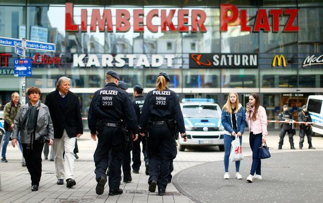 Police walks towards the Limbecker Platz shopping mall in Essen,