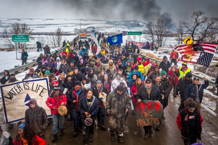 An hour prior to the deadline, a ceremonial exit of Oceti Sakowin. In December, some estimates were well over 10,000 people w