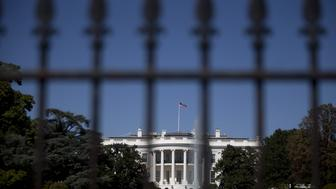 The south side of the White House stands past a fence in Washington, D.C., U.S., on Monday, Sept. 22, 2014. A security review prompted by an intruder entering the White House last week may include a fresh look at restrictions rejected in the past, including tourist checkpoints outside the grounds, a federal law enforcement official said. Photographer: Andrew Harrer/Bloomberg via Getty Images