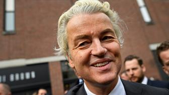 Dutch far-right politician Geert Wilders of the PVV party smiles during a rally in Heerlan, Netherlands, March 11, 2017. REUTERS/Dylan Martinez