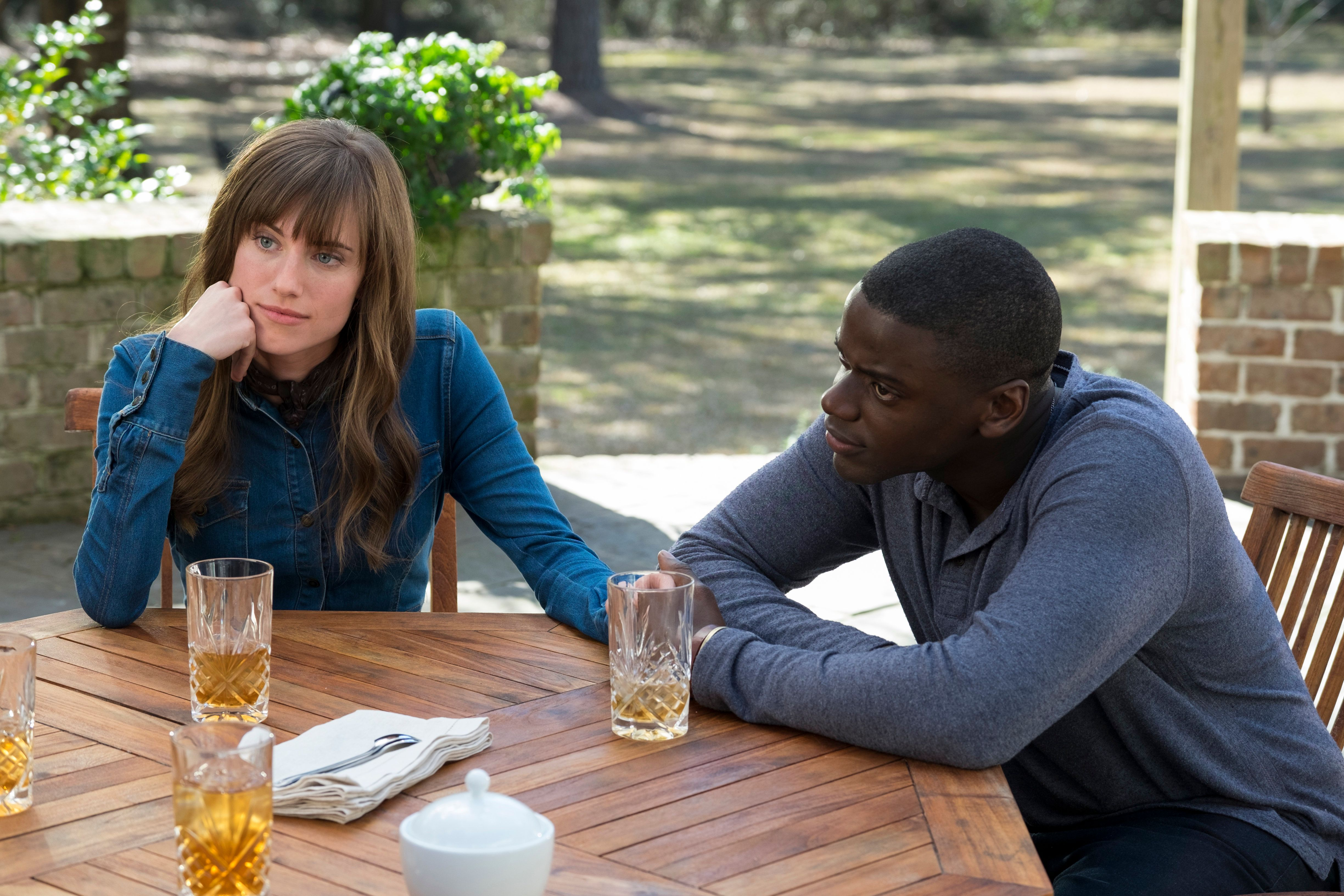 "Rose (ALLISON WILLIAMS) connects with boyfriend Chris (DANIEL KALUUYA) in Universal Pictures' ""Get Out,"" a speculative thriller from Blumhouse (producers of ""The Visit,"" ""Insidious"" series and ""The Gift"") and the mind of Jordan Peele.  When a young African-American man visits his white girlfriend's family estate, he becomes ensnared in a more sinister real reason for the invitation."