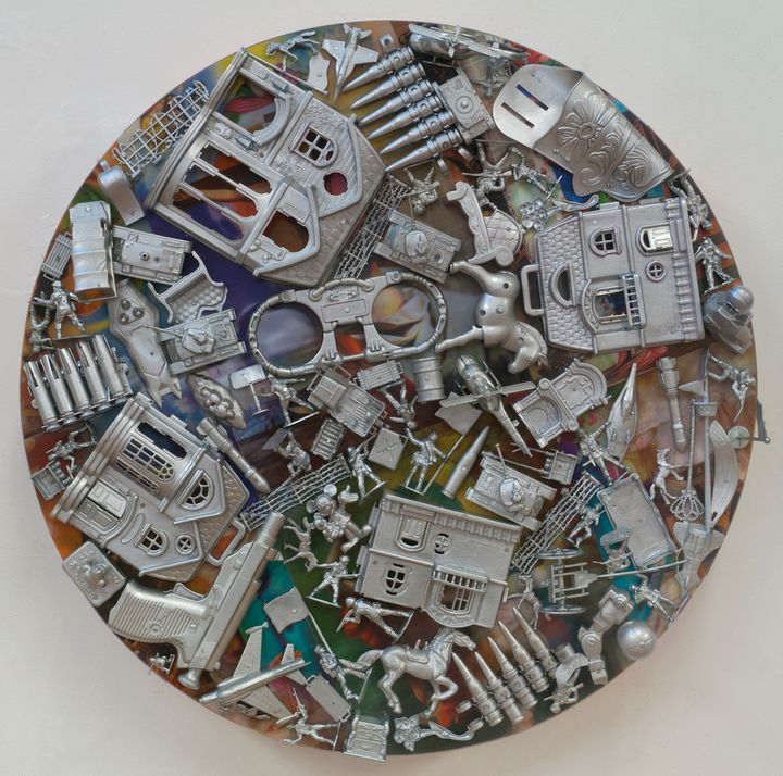 Margaret Roleke, <em>War Life </em>(2015), lenticular collage with painted plastic toys on wood structure, 24 inches diameter