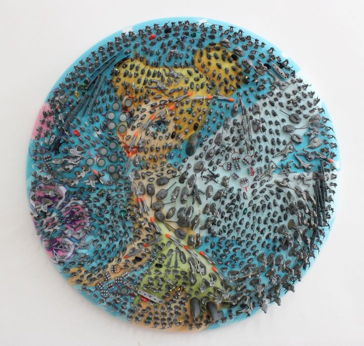 Margaret Roleke, <em>Tink's Army, </em>plastic toys on fabric, 30 inches in diameter by 3 inches deep