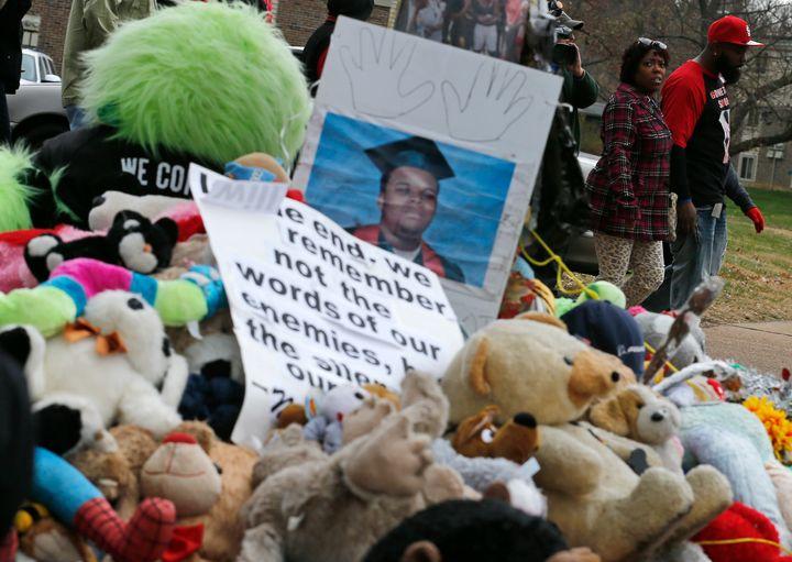 Michael Brown Sr. walks past the memorial set up where his son Michael Brown was shot and killed in Ferguson, Missouri, Nov.
